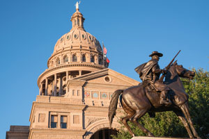 Texas Capitol with Texas Rangers Monument Statue