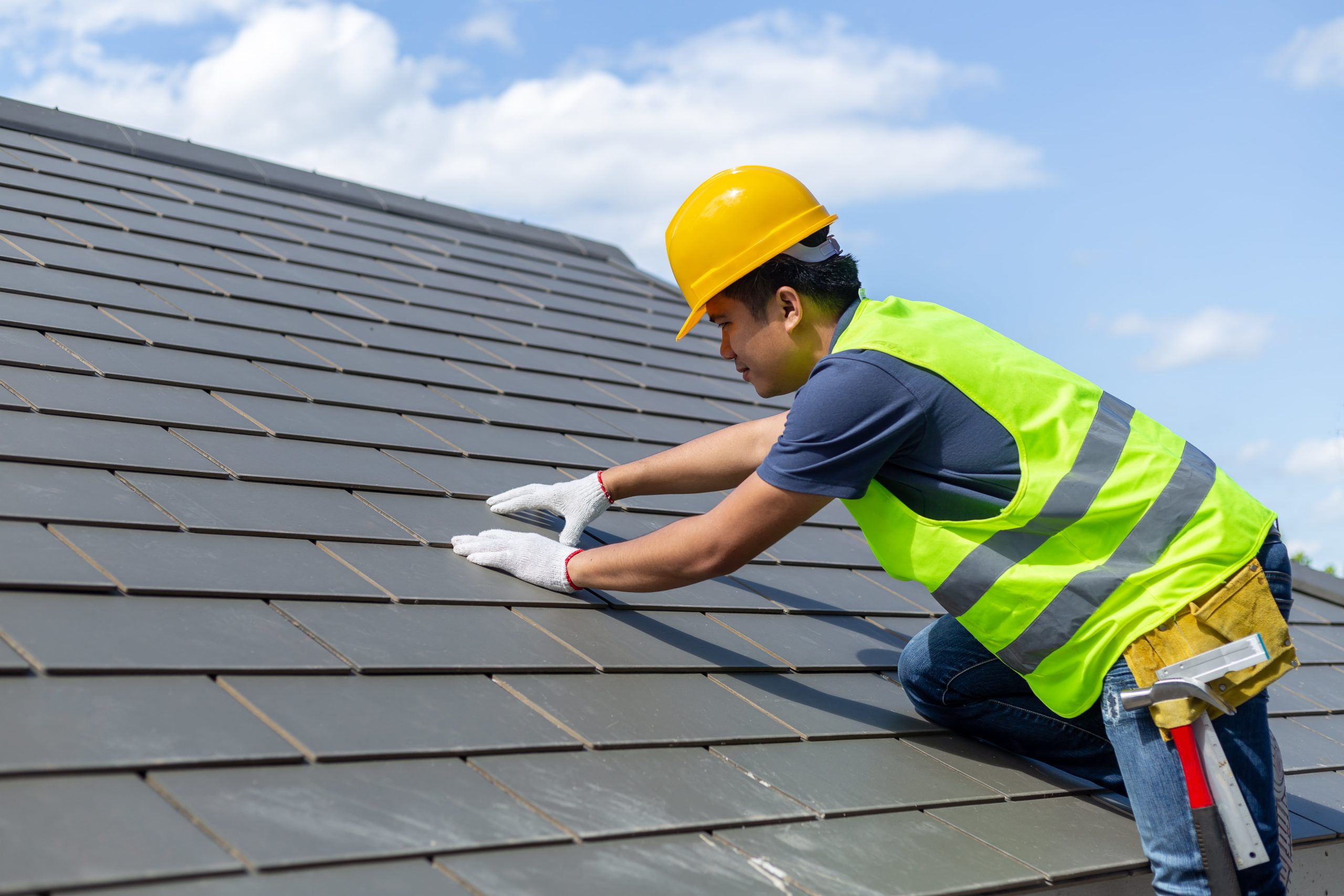 Roofer Working on a Roof - Roofing Companies - Get Your Quote