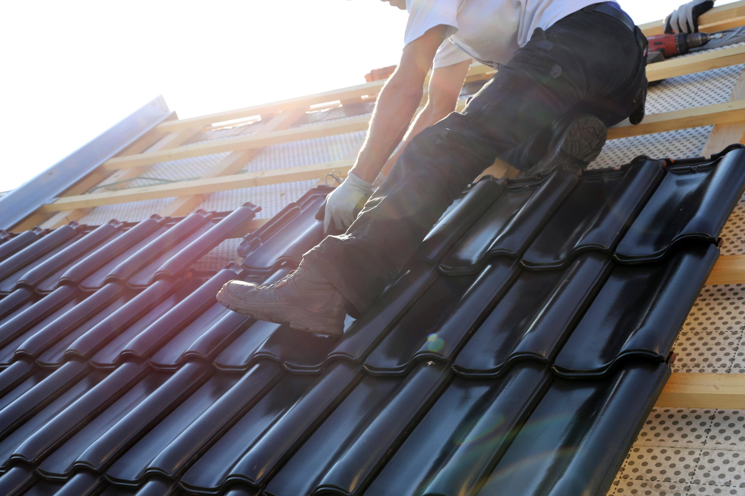 Roofer Installing Roofing Tiles - Rofing Companies - Get Your Quote