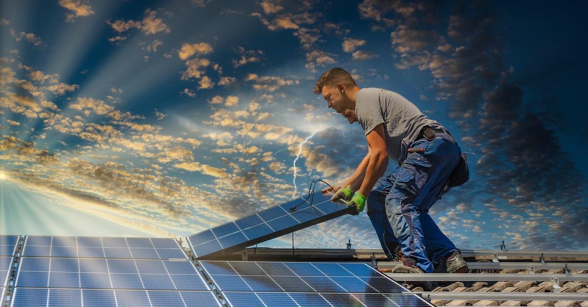 guy installing solar panels