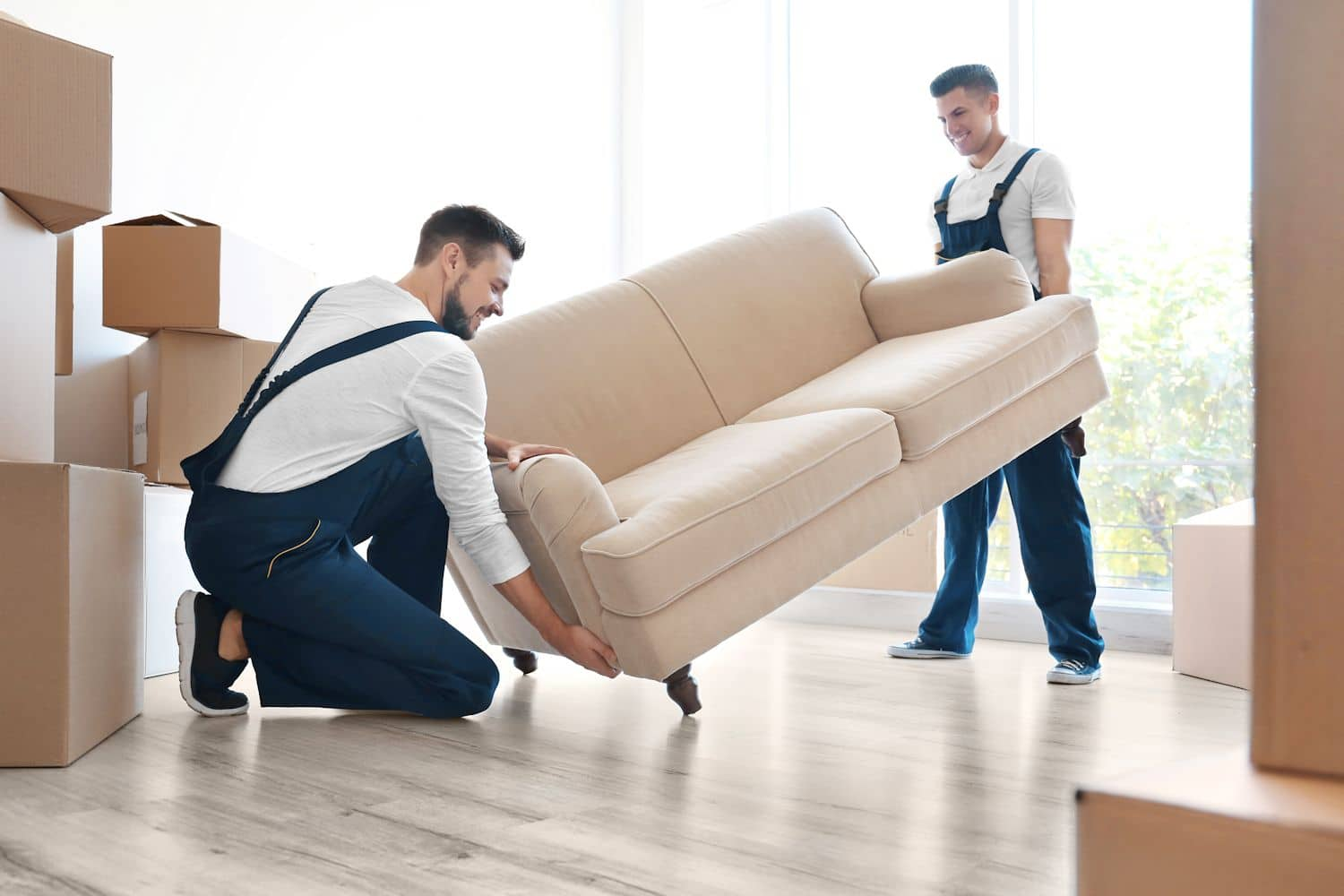 men moving a sofa