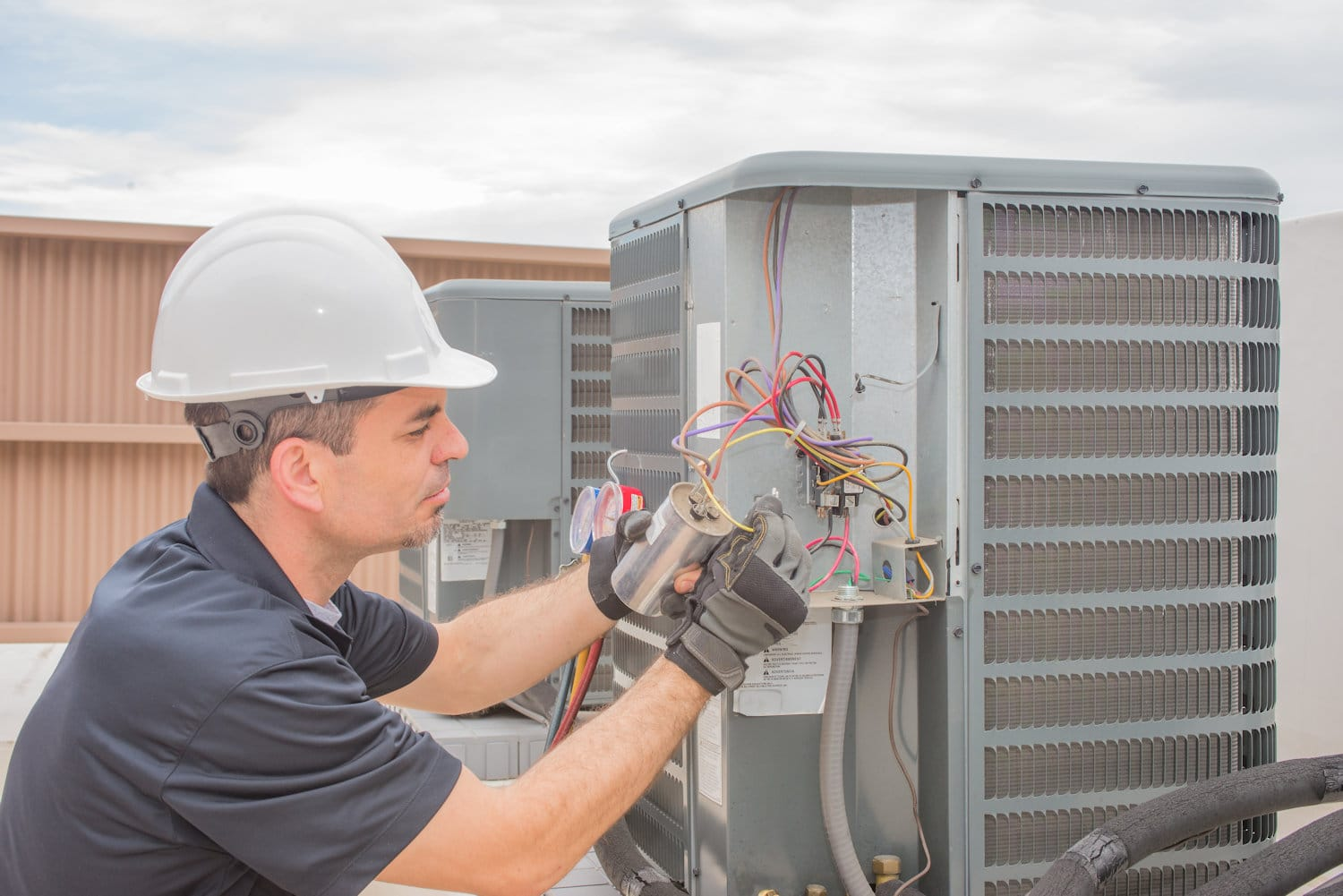 HVAC Repair Man Fixing AC - Find Contractors - Get Your Quote
