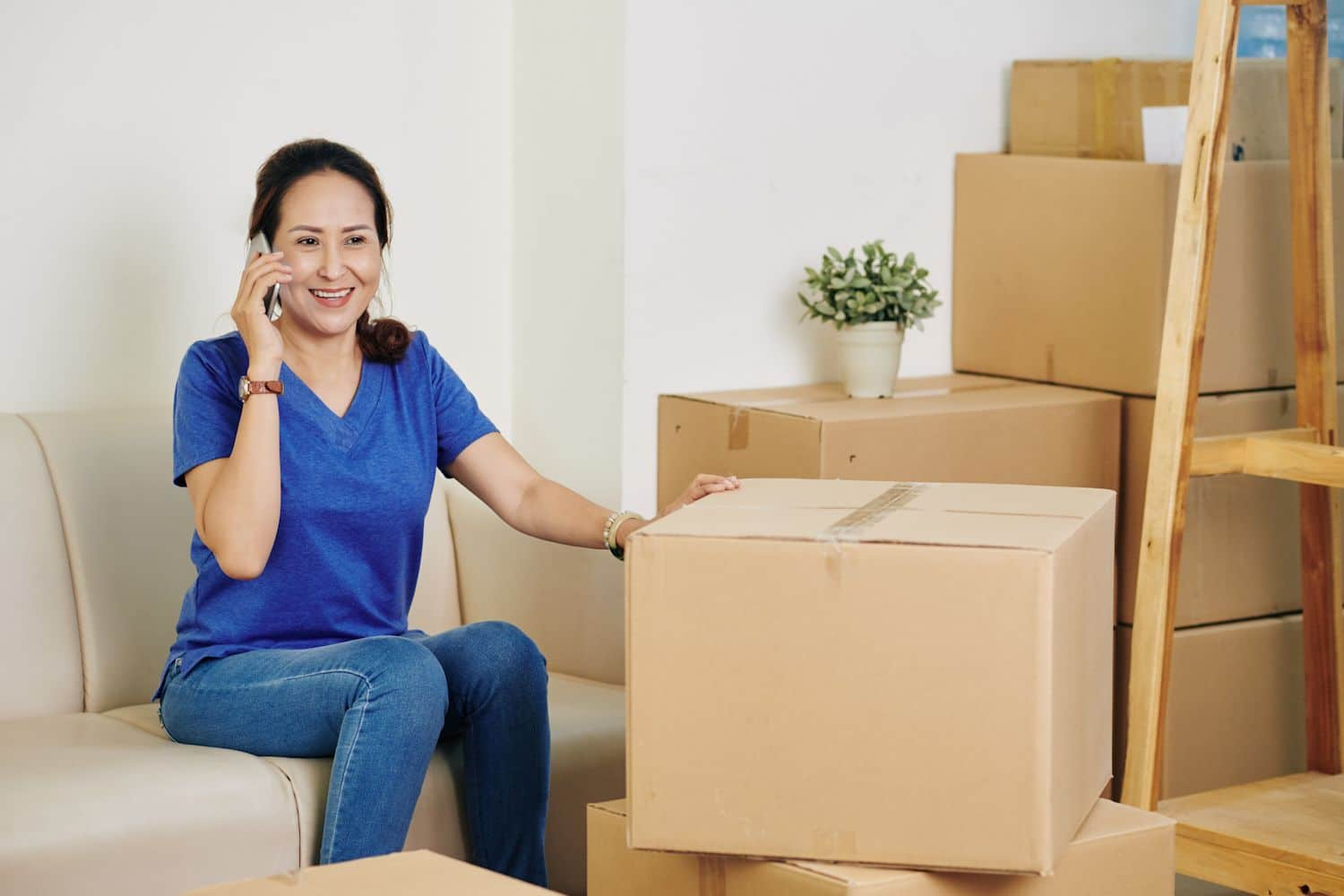 woman-on-phone-w-moving-company