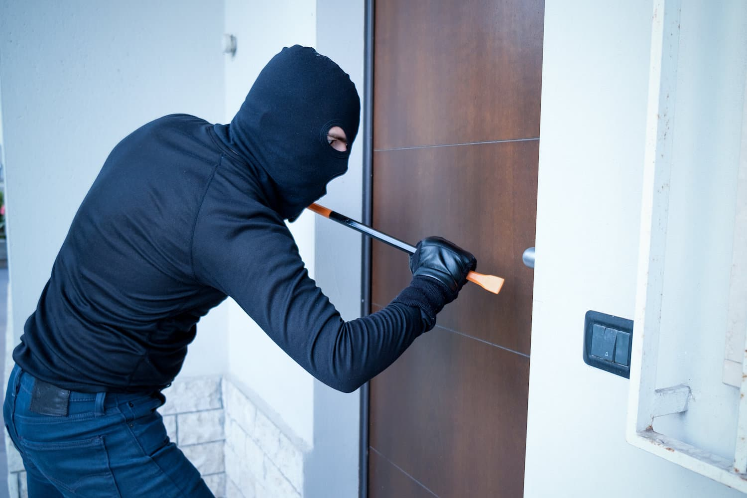 burglar prying open front door