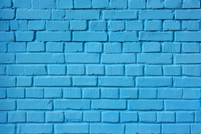 brick wall painted blue